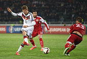 Thomas Mueller of Germany misses to score against Levan Mchedlidze of Georgia during the EURO 2016 Group D Qualifier match between Georgia and...