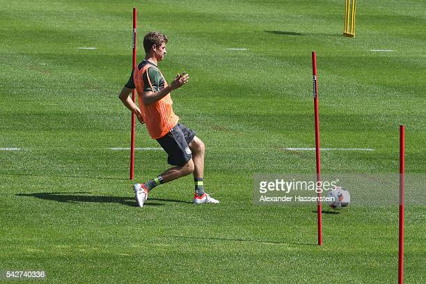 Thomas Mueller of Germany plays with the ball during a Germany training session at Ermitage Evian on June 24 2016 in EvianlesBains France