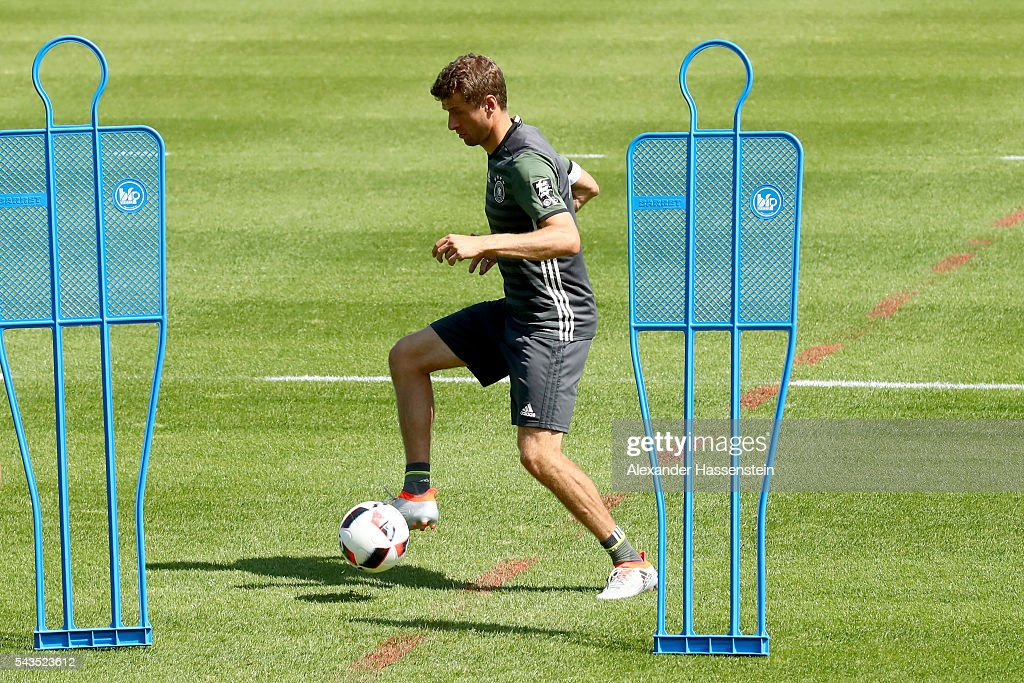 <a gi-track='captionPersonalityLinkClicked' href=/galleries/search?phrase=Thomas+Mueller&family=editorial&specificpeople=5842906 ng-click='$event.stopPropagation()'>Thomas Mueller</a> of Germany plays with the ball during a Germany training session at Ermitage Evian on June 29, 2016 in Evian-les-Bains, France.