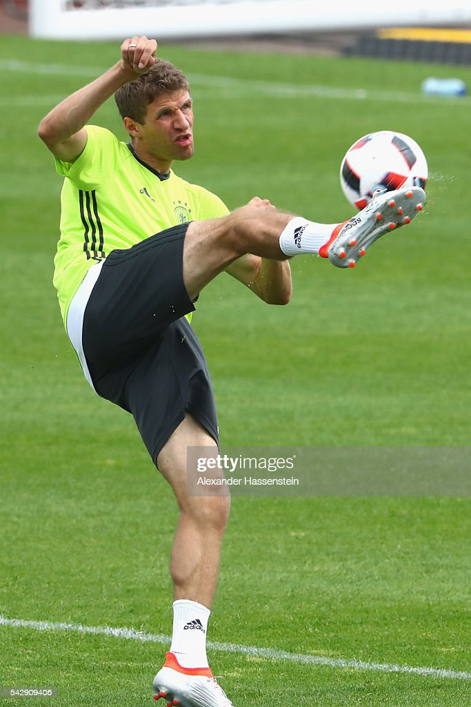 <a gi-track='captionPersonalityLinkClicked' href=/galleries/search?phrase=Thomas+Mueller&family=editorial&specificpeople=5842906 ng-click='$event.stopPropagation()'>Thomas Mueller</a> of Germany plays with the ball during a Germany training session ahead of their Euro 2016 round of 16 match against Slovakia at Ermitage Evian on June 25, 2016 in Evian-les-Bains, France.