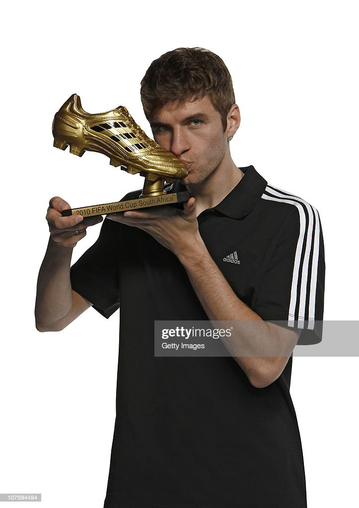 Thomas Mueller of Germany poses with the adidas Golden Boot Winner Trophy at the adidas HQ on December 14, 2010 in Herzogenaurach, Germany.