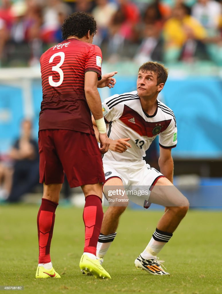 <a gi-track='captionPersonalityLinkClicked' href=/galleries/search?phrase=Thomas+Mueller&family=editorial&specificpeople=5842906 ng-click='$event.stopPropagation()'>Thomas Mueller</a> of Germany reacts after a headbutt by <a gi-track='captionPersonalityLinkClicked' href=/galleries/search?phrase=Pepe+-+Portuguese+Soccer+Player&family=editorial&specificpeople=4401229 ng-click='$event.stopPropagation()'>Pepe</a> of Portugal resulting in a red card during the 2014 FIFA World Cup Brazil Group G match between Germany and Portugal at Arena Fonte Nova on June 16, 2014 in Salvador, Brazil.