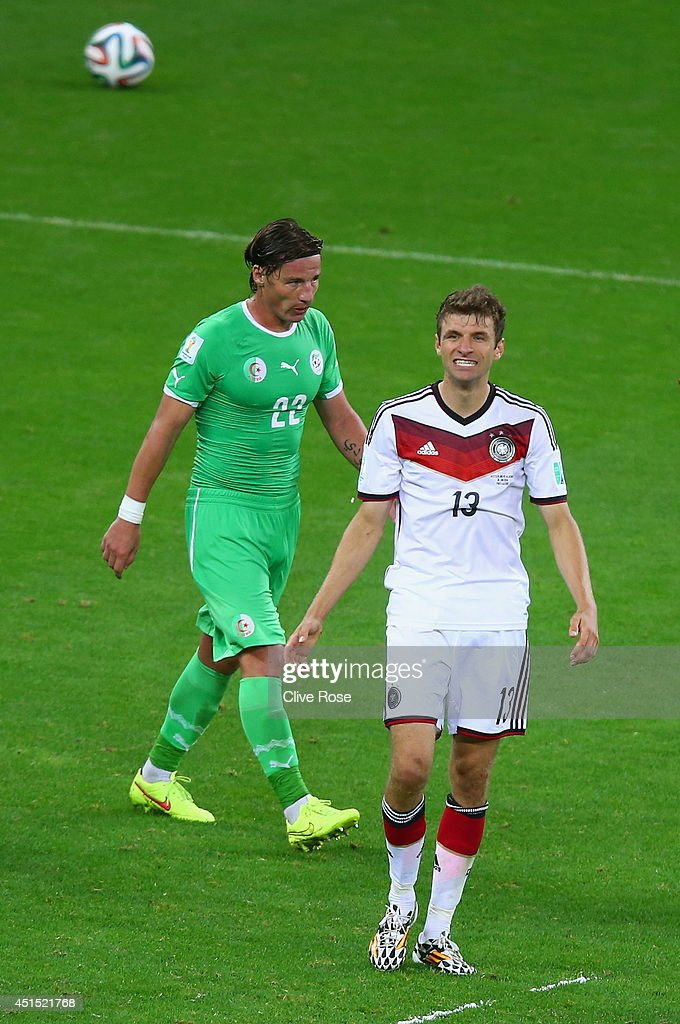 <a gi-track='captionPersonalityLinkClicked' href=/galleries/search?phrase=Thomas+Mueller&family=editorial&specificpeople=5842906 ng-click='$event.stopPropagation()'>Thomas Mueller</a> of Germany reacts after a missed chance as <a gi-track='captionPersonalityLinkClicked' href=/galleries/search?phrase=Mehdi+Mostefa&family=editorial&specificpeople=6328029 ng-click='$event.stopPropagation()'>Mehdi Mostefa</a> of Algeria looks on during the 2014 FIFA World Cup Brazil Round of 16 match between Germany and Algeria at Estadio Beira-Rio on June 30, 2014 in Porto Alegre, Brazil.