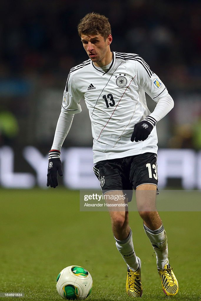 Thomas Mueller of Germany runs with the ball during the FIFA 2014 World Cup qualifier group C match between Germany and Kazakhstan at Gundig-Stadion on March 26, 2013 in Nuremberg, Germany.