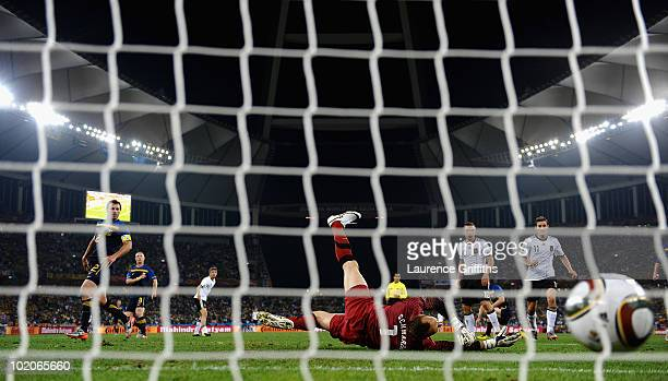 Thomas Mueller of Germany scores his side's third goal past Mark Schwarzer of Australia during the 2010 FIFA World Cup South Africa Group D match...