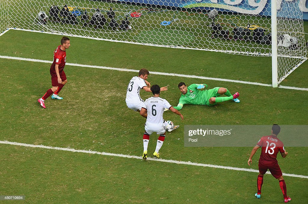 Thomas Mueller of Germany scores his team's fourth goal and completes his hat trick past Rui Patricio of Portugal during the 2014 FIFA World Cup Brazil Group G match between Germany and Portugal at Arena Fonte Nova on June 16, 2014 in Salvador, Brazil.