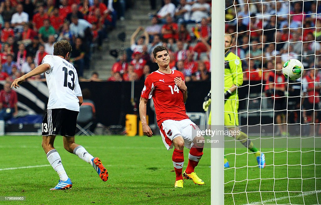 <a gi-track='captionPersonalityLinkClicked' href=/galleries/search?phrase=Thomas+Mueller&family=editorial&specificpeople=5842906 ng-click='$event.stopPropagation()'>Thomas Mueller</a> of Germany scores his teams third goal during the FIFA 2014 World Cup Qualifying Group C match between Germany and Austria Allianz Arena on September 6, 2013 in Munich, Germany.