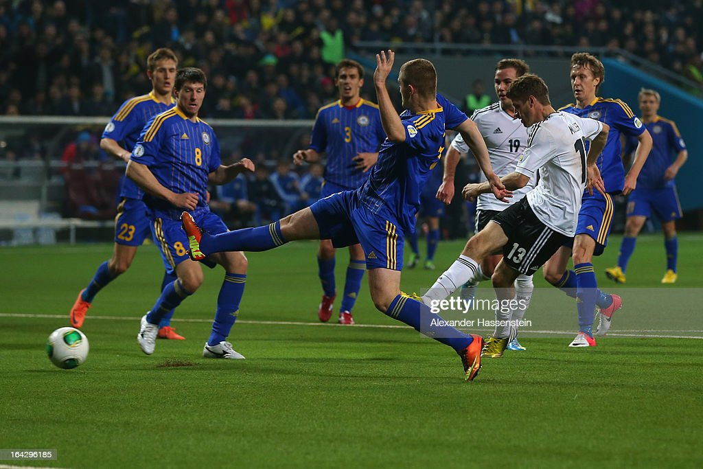 Thomas Mueller (R) of Germany scores the 4th team during the FIFA 2014 World Cup qualifier group C match between Kazakhstan and Germany at Astana Arena on March 22, 2013 in Astana, Kazakhstan.