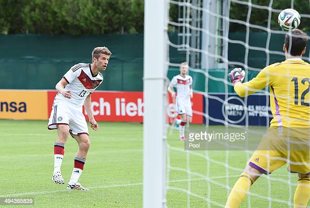 Thomas Mueller of Germany scores the first goal in the second match against goalkeeper Marius Mueller of Germany U20 during the German National team...