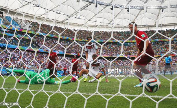 Thomas Mueller of Germany scores the team's fourth goal past Rui Patricio of Portugal during the 2014 FIFA World Cup Brazil Group G match between...
