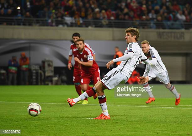 Thomas Mueller of Germany scores their first goal from the penalty spot during the UEFA EURO 2016 Group D qualifying match between Germany and...