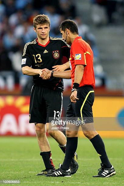 Thomas Mueller of Germany shakes hands with Referee Ravshan Irmatov after winning the 2010 FIFA World Cup South Africa Quarter Final match between...