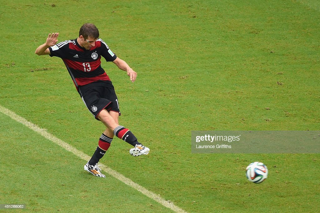 Thomas Mueller of Germany shoots and scores his team's first goal during the 2014 FIFA World Cup Brazil group G match between the United States and Germany at Arena Pernambuco on June 26, 2014 in Recife, Brazil.