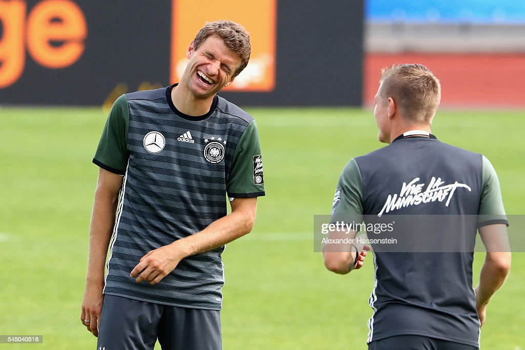 Thomas Mueller (L) of Germany smiles with his team mate Toni Kroos during a Germany training session at Ermitage Evian on July 05, 2016 in Evian-les-Bains, France.