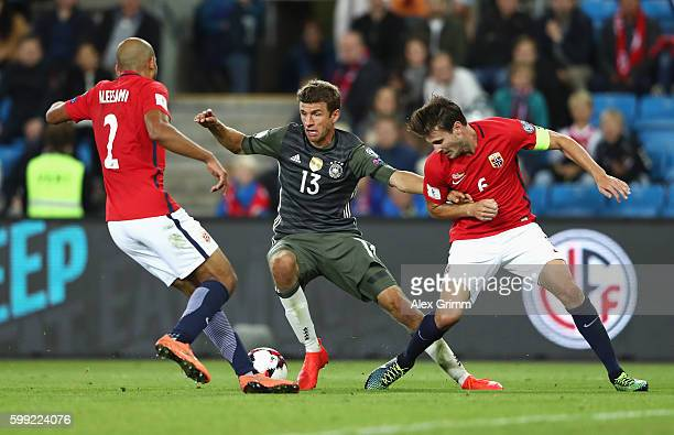 Thomas Mueller of Germany takes on Haitam Aleesami and Havard Nordtveit of Norway during the 2018 FIFA World Cup Qualifier Group C match between...