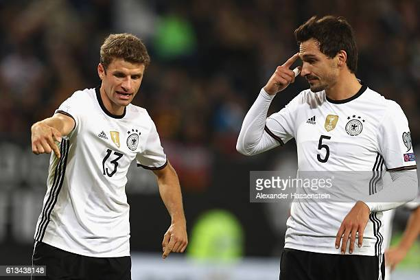 Thomas Mueller of Germany talks to his team mate Mats Hummels during the 2018 FIFA World Cup Qualifier match between Germany and Czech Republic at...