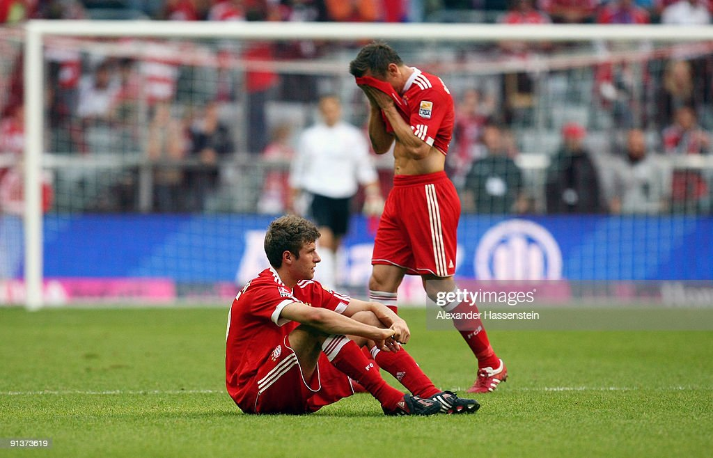 Thomas Mueller (botton) of Muenchen and his team mate Ivica Olic react after the Bundesliga match between FC Bayern Muenchen and 1. FC Koeln at Allianz Arena on October 3, 2009 in Munich, Germany.