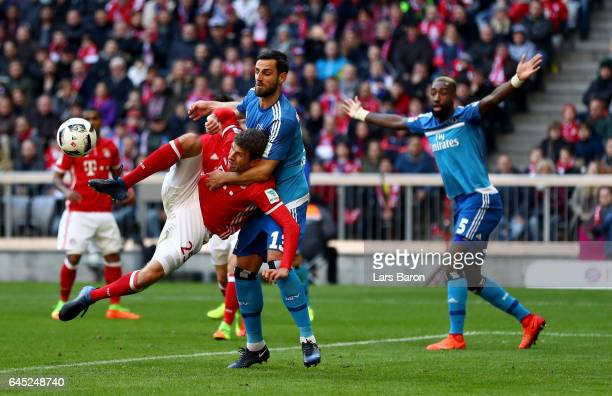 Thomas Mueller of Muenchen and Mergim Mavraj of Hamburg battle for the ball during the Bundesliga match between Bayern Muenchen and Hamburger SV at...