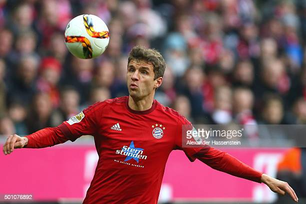 Thomas Mueller of Muenchen battles for the ball during the Bundesliga match between FC Bayern Muenchen and FC Ingolstadt at Allianz Arena on December...