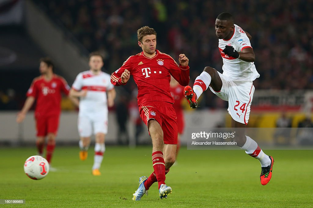 Thomas Mueller (L) of Muenchen battles for the ball with Antonio Ruediger of Stuttgart during the Bundesliga match between VfB Stuttgart and FC Bayern Muenchen at Mercedes-Benz Arena on January 27, 2013 in Stuttgart, Germany.