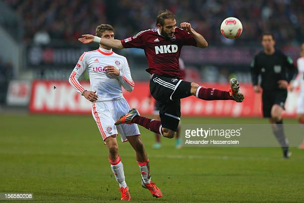 Thomas Mueller of Muenchen battles for the ball with Javier Pinola of Nuernberg during the Bundesliga match between 1 FC Nuernberg and FC Bayern...
