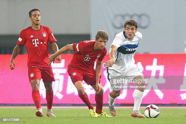 Thomas Mueller of Muenchen battles for the ball with Mateo Kovacic of Milan during the international friendly match between FC Bayern Muenchen and...