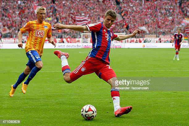 Thomas Mueller of Muenchen battles for the ball with Per Ciljian Skjelbred of Berlin during the Bundesliga match between FC Bayern Muenchen and...