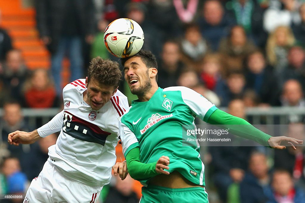 Thomas Mueller of Muenchen battles for the ball with Santiago Garcia of Bremen during the Bundesliga match between SV Werder Bremen and FC Bayern...