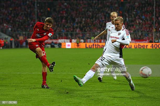 Thomas Mueller of Muenchen battles for the ball with Stefan Wannenwetsch of Ingolstadt during the Bundesliga match between FC Bayern Muenchen and FC...
