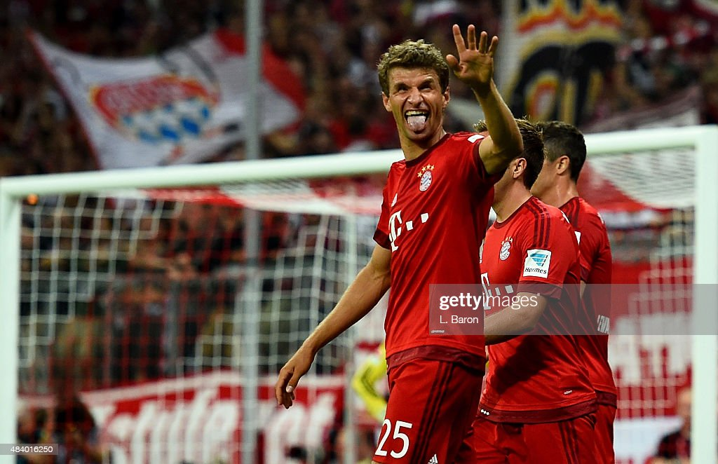 Thomas Mueller of Muenchen celebrates after scoring his teams third goal during the Bundesliga match between FC Bayern Muenchen and Hamburger SV at...