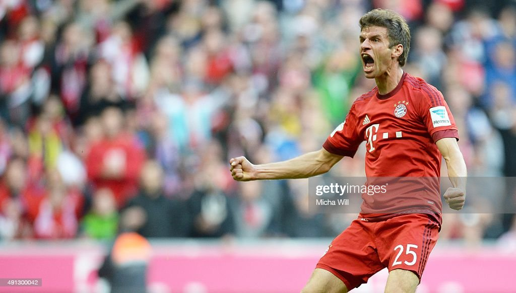 Thomas Mueller of Muenchen celebrates after scoring the opening/first goal during the Bundesliga match between FC Bayern Muenchen and Borussia Dortmund at Allianz Arena on October 4, 2015 in Munich, Germany.