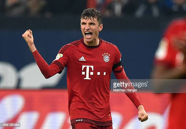 Thomas Mueller of Muenchen celebrates after the Bundesliga match between FC Schalke 04 and FC Bayern Muenchen at VeltinsArena on November 21 2015 in...