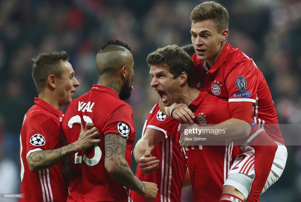 Thomas Mueller (2R) of Muenchen celebrates his team's fifth goal with team mates Rafinha, Arturo Vidal and Joshua Kimmich (L-R) during the UEFA Champions League Round of 16 first leg match between FC Bayern Muenchen and Arsenal FC at Allianz Arena on February 15, 2017 in Munich, Germany.
