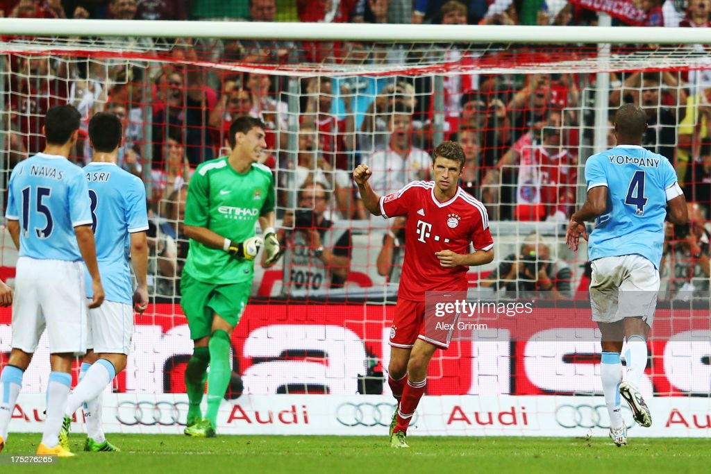 <a gi-track='captionPersonalityLinkClicked' href=/galleries/search?phrase=Thomas+Mueller&family=editorial&specificpeople=5842906 ng-click='$event.stopPropagation()'>Thomas Mueller</a> of Muenchen celebrates his team's first goal during the Audi Cup Final match between FC Bayern Muenchen and Manchester City at Allianz Arena on August 1, 2013 in Munich, Germany.