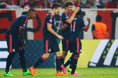 Thomas Mueller of Muenchen celebrates his team's first goal with team mates Jerome Boateng Robert Lewandowski and Douglas Costa during the UEFA...