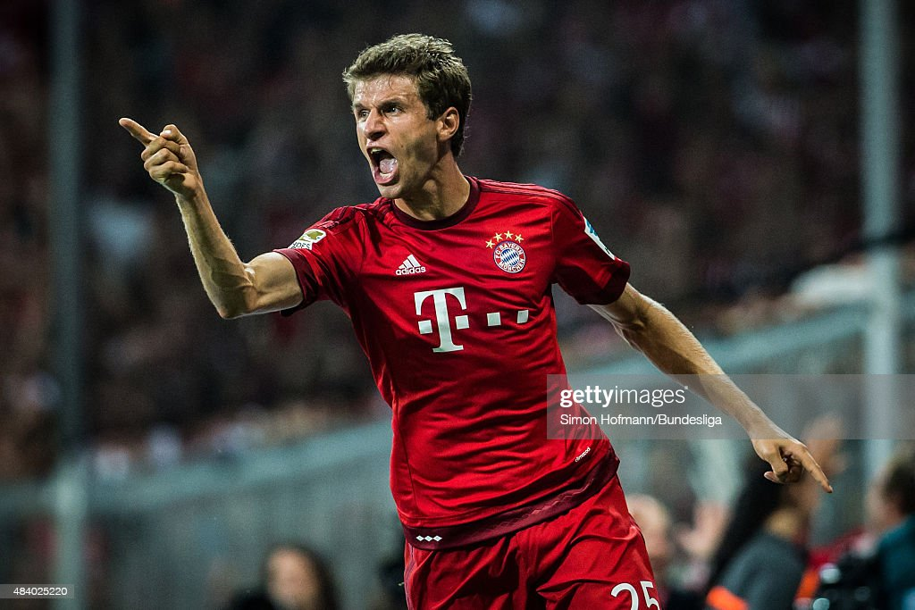 <a gi-track='captionPersonalityLinkClicked' href=/galleries/search?phrase=Thomas+Mueller&family=editorial&specificpeople=5842906 ng-click='$event.stopPropagation()'>Thomas Mueller</a> of Muenchen celebrates his team's third goal during the Bundesliga match between FC Bayern Muenchen and Hamburger SV at Allianz Arena on August 14, 2015 in Munich, Germany.