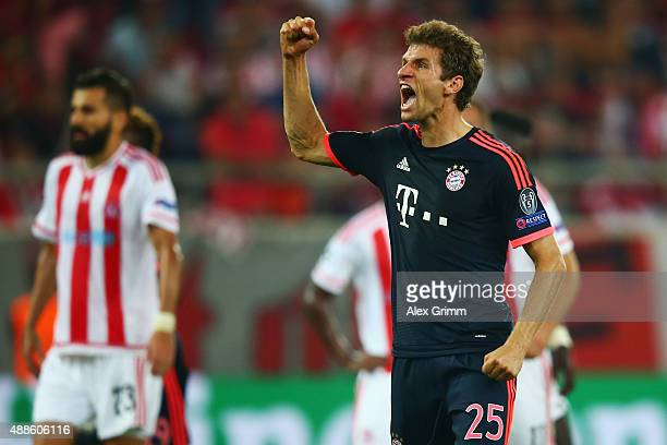 Thomas Mueller of Muenchen celebrates his team's third goal during the UEFA Champions League Group F match between Olympiacos FC and FC Bayern...