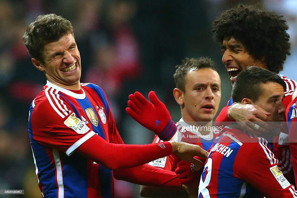 <a gi-track='captionPersonalityLinkClicked' href=/galleries/search?phrase=Thomas+Mueller&family=editorial&specificpeople=5842906 ng-click='$event.stopPropagation()'>Thomas Mueller</a> (L) of Muenchen celebrates scoring the 2nd team goal with his team mate Dante (R) and others during the Bundesliga match between FC Bayern Muenchen and SC Freiburg at Allianz Arena on December 16, 2014 in Munich, Germany.