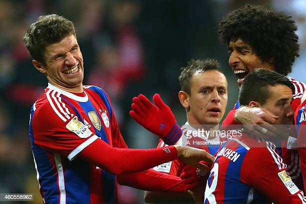 Thomas Mueller of Muenchen celebrates scoring the 2nd team goal with his team mate Dante and others during the Bundesliga match between FC Bayern...