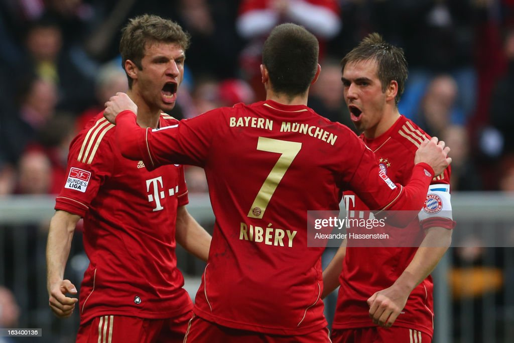 Thomas Mueller (L) of Muenchen celebrates scoring the first team goal with his team mates Franck Ribery (C) and Philipp Lahm during the Bundesliga match between FC Bayern Muenchen and Fortuna Duesseldorf 1895 at Allianz Arena on March 9, 2013 in Munich, Germany.