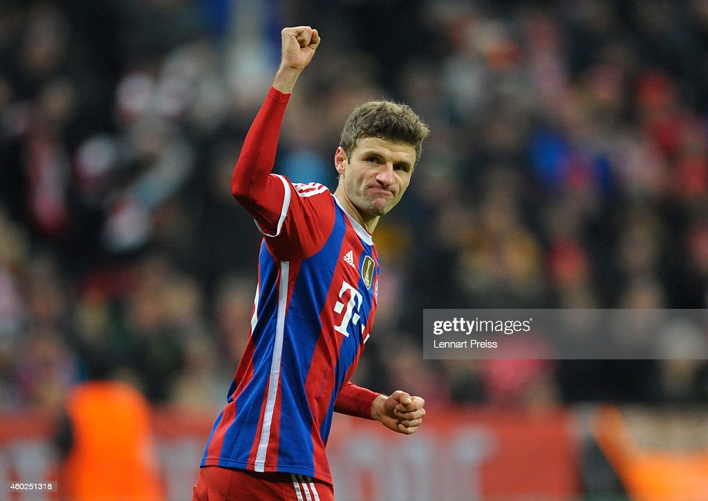 Thomas Mueller of Muenchen celebrates scoring the opening goal during the UEFA Champions League Group E match between FC Bayern Muenchen and PFC CSKA Moskva at Allianz Arena on December 10, 2014 in Munich, Germany.