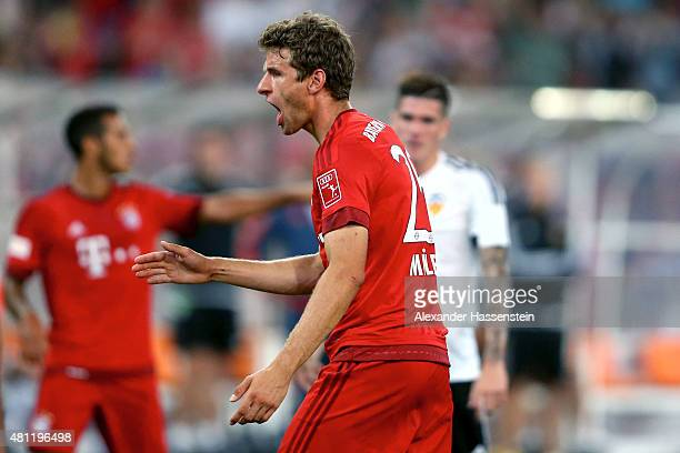 Thomas Mueller of Muenchen celebrates scoring the opening goal during the international friendly match between FC Bayern Muenchen and Valencia FC at...