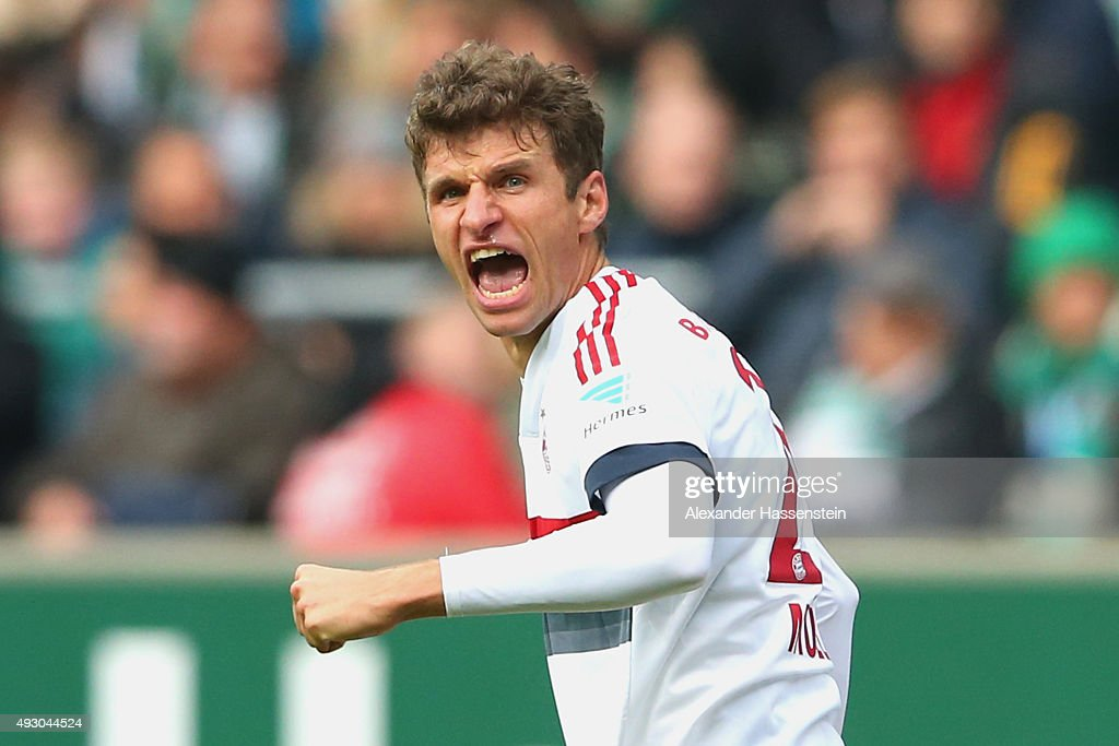 Thomas Mueller of Muenchen celebrates scoring the opening goal during the Bundesliga match between SV Werder Bremen and FC Bayern Muenchen at...