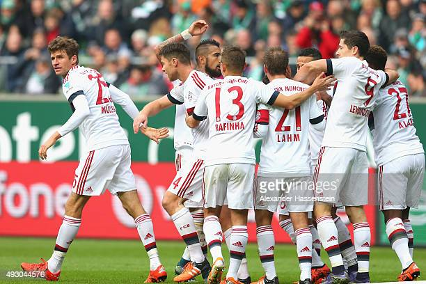 Thomas Mueller of Muenchen celebrates scoring the opening goal with his team mates during the Bundesliga match between SV Werder Bremen and FC Bayern...