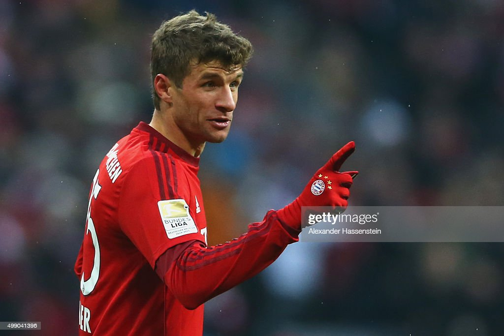 Thomas Mueller of Muenchen celebrates scoring the second team during the Bundesliga match between FC Bayern Muenchen and Herha BSC Berlin at Allianz Arena on November 28, 2015 in Munich, Germany.