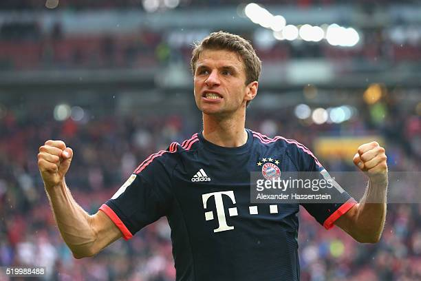 Thomas Mueller of Muenchen celebrates victory after winning the Bundesliga match between VfB Stuttgart and FC Bayern Muenchen at MercedesBenz Arena...