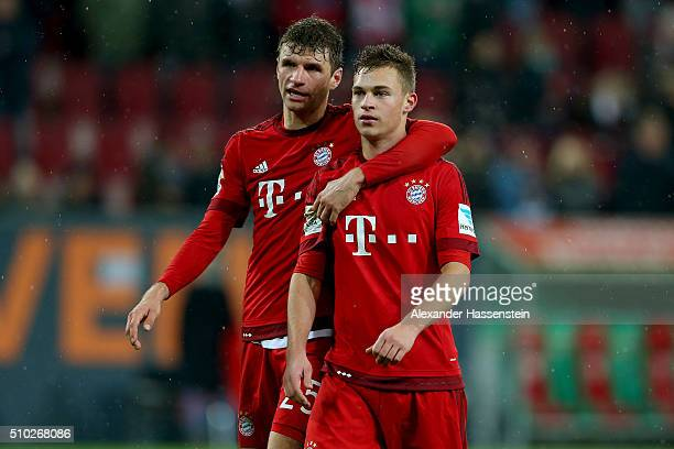 Thomas Mueller of Muenchen celebrates with his team mate Joshua Kimmich after the Bundesliga match between FC Augsburg and FC Bayern Muenchen at WWK...
