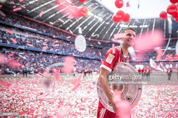 Thomas Mueller of Muenchen celebrates with the trophy after the Bundesliga match between Bayern Muenchen and SC Freiburg at Allianz Arena on May 20...