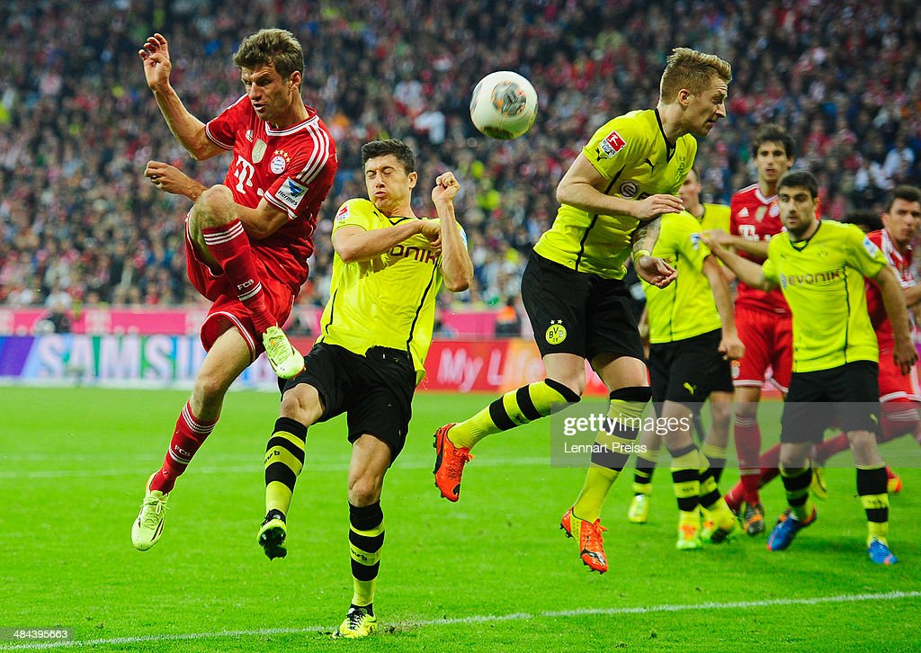 <a gi-track='captionPersonalityLinkClicked' href=/galleries/search?phrase=Thomas+Mueller&family=editorial&specificpeople=5842906 ng-click='$event.stopPropagation()'>Thomas Mueller</a> (L-R) of Muenchen challenges <a gi-track='captionPersonalityLinkClicked' href=/galleries/search?phrase=Robert+Lewandowski&family=editorial&specificpeople=5532633 ng-click='$event.stopPropagation()'>Robert Lewandowski</a> and <a gi-track='captionPersonalityLinkClicked' href=/galleries/search?phrase=Marco+Reus&family=editorial&specificpeople=5445884 ng-click='$event.stopPropagation()'>Marco Reus</a> of Dortmund during the Bundesliga match between FC Bayern Muenchen and Borussia Dortmund at Allianz Arena on April 12, 2014 in Munich, Germany.
