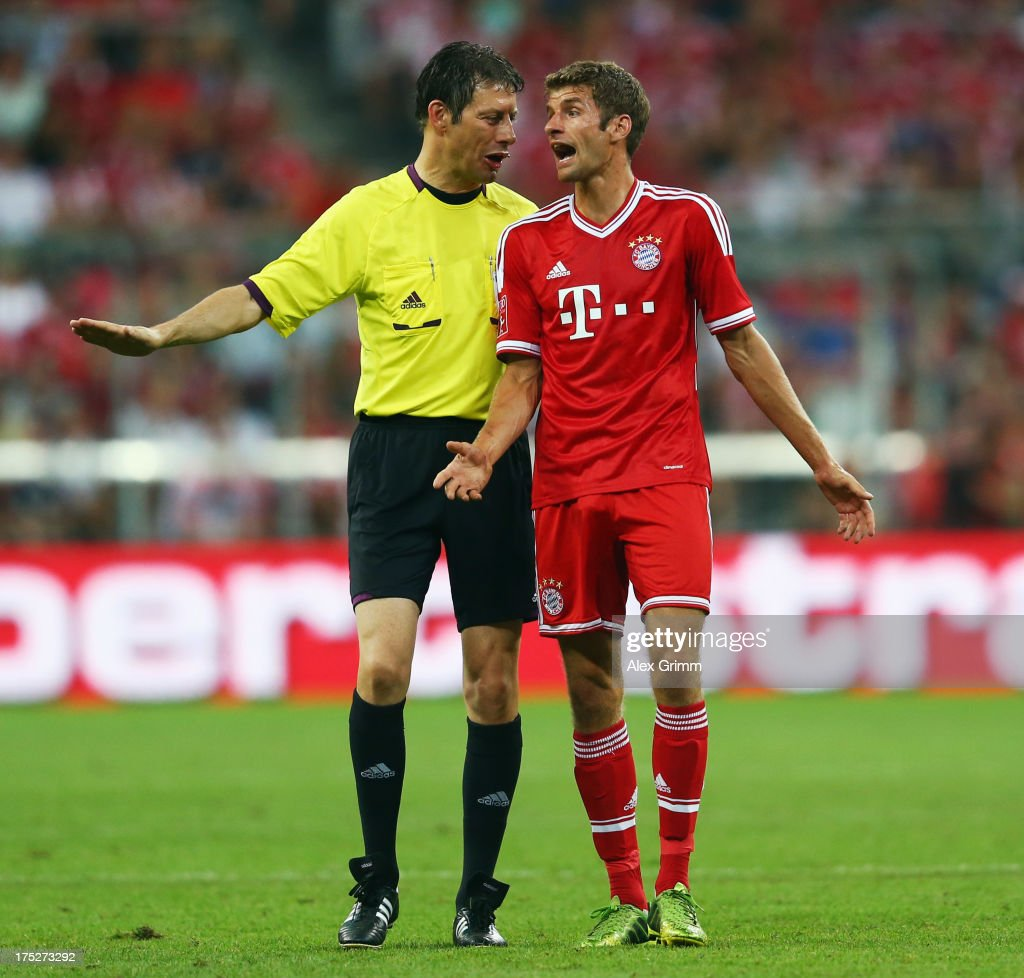 Thomas Mueller of Muenchen discusses with referee Wolfgang Stark during the Audi Cup Final match between FC Bayern Muenchen and Manchester City at Allianz Arena on August 1, 2013 in Munich, Germany.